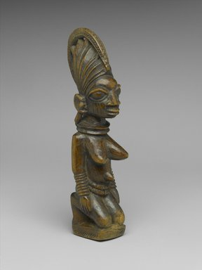Yorùbá. <em>Kneeling Female Figure</em>, late 19th or early 20th century. Wood, 8 1/2 x 2 x 2 1/2 in. (21.6 x 5.1 x 6.4 cm). Brooklyn Museum, Gift of Mr. and Mrs. Joseph Gerofsky in honor of Ruth Lippman, 1992.70. Creative Commons-BY (Photo: Brooklyn Museum, 1992.70_threequarter_PS2.jpg)