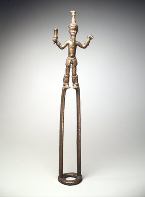 Duahn Yibay (Dan, flourished 1920s-1930s). <em>Figure of a Dancer</em>, late 19th or early 20th century. Copper alloy, 20 1/2 x 5 1/4 x 1 3/8 in.  (52.1 x 13.3 x 3.5 cm). Brooklyn Museum, Gift of Harry S. Glaze, 1992.71.2. Creative Commons-BY (Photo: Brooklyn Museum, 1992.71.2_transp4461.jpg)