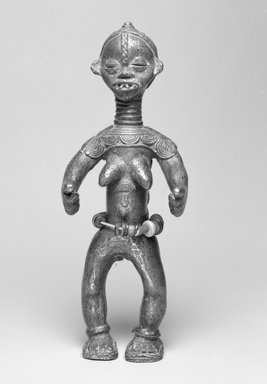 Possibly Ldamie (Dan, flourished 1920s-1930s). <em>Female Figure</em>, early 20th century. Copper alloy, rubber and glass beads, fiber, 9 1/4 x 3 9/16 x 2 3/4 in. (23.5 x 9 x 7 cm). Brooklyn Museum, Gift of Harry S. Glaze, 1992.71.3. Creative Commons-BY (Photo: Brooklyn Museum, 1992.71.3_bw.jpg)