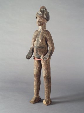 Igbo (northern). <em>Standing Female Shrine Figure</em>, early 20th century. Wood, pigment, plastic beads, 44 x 11 1/2 x 8 3/4 in. (111.6 x 29.3 x 22.2 cm). Brooklyn Museum, Gift of Frieda and Milton F. Rosenthal, 1992.74.2. Creative Commons-BY (Photo: Brooklyn Museum, 1992.74.2_transpc001.jpg)