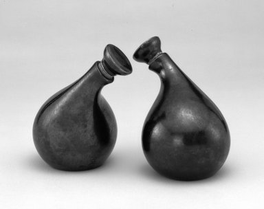 "Eva Zeisel (American, born Hungary, 1906-2011). <em>Cruet and Stopper, ""Town and Country"" Pattern</em>, ca. 1942-1943. Earthenware, cork, 5 5/8 x 5 x 3 1/2 in.  (14.3 x 12.7 x 8.9 cm). Brooklyn Museum, Gift of Paul F. Walter