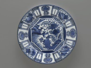 <em>Arita Blue and White Charger</em>, ca. 1680. Porcelain, blue underglaze, in Wan Li style, 3 x 18 1/8 in. (7.6 x 46 cm). Brooklyn Museum, Gift of Dr. Bertram H. Schaffner, 1993.106.10. Creative Commons-BY (Photo: Brooklyn Museum, 1993.106.10_PS2.jpg)