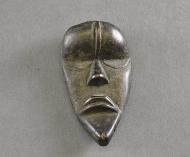 Dan. <em>Personal Miniature Mask</em>, 20th century. Wood, 3 1/2 x 1 7/8in. (8.9 x 4.8cm). Brooklyn Museum, Gift of Dr. Svend E. Holsoe, 1993.175.13. Creative Commons-BY (Photo: Brooklyn Museum, 1993.175.13_front_PS5.jpg)