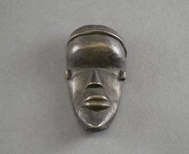 Dan. <em>Personal Miniature Mask</em>, 20th century. Wood, 4 x 2 1/4in. (10.2 x 5.7cm). Brooklyn Museum, Gift of Dr. Svend E. Holsoe, 1993.175.6. Creative Commons-BY (Photo: Brooklyn Museum, 1993.175.6_front_PS5.jpg)