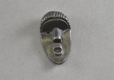 Bassa. <em>Personal Miniature Mask</em>, 20th century. Wood, 2 3/4 x 1 1/2 in. (7 x 3.8 cm). Brooklyn Museum, Gift of Dr. Svend E. Holsoe, 1993.175.8. Creative Commons-BY (Photo: Brooklyn Museum, 1993.175.8_front_PS5.jpg)