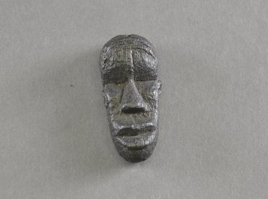 Bassa. <em>Personal Miniature Mask</em>, 20th century. Wood, 2 3/8 x 1 1/16 in. (6 x 2.7 cm). Brooklyn Museum, Gift of Dr. Svend E. Holsoe, 1993.175.9. Creative Commons-BY (Photo: Brooklyn Museum, 1993.175.9_front_PS5.jpg)