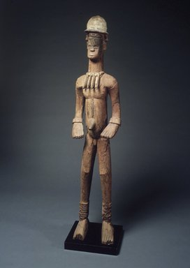 Igbo. <em>Standing Male Shrine Figure</em>, 20th century. Wood, pigment, string, organic matter, 61 1/2 x 13 1/2 x 10 in. (156.3 x 34.3 x 25.5 cm). Brooklyn Museum, Gift of Mr. and Mrs. Lee Lorenz, 1993.179.1. Creative Commons-BY (Photo: Brooklyn Museum, 1993.179.1_transpc001.jpg)