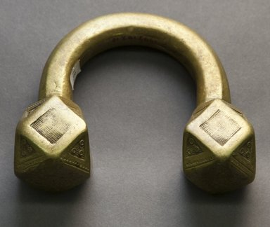<em>Bracelet</em>, 19th or 20th century. Brass, 4 1/4 x 5 in. Brooklyn Museum, Gift of Mr. and Mrs. Arnold Syrop, 1993.183.10. Creative Commons-BY (Photo: Brooklyn Museum, 1993.183.10_front_PS10.jpg)