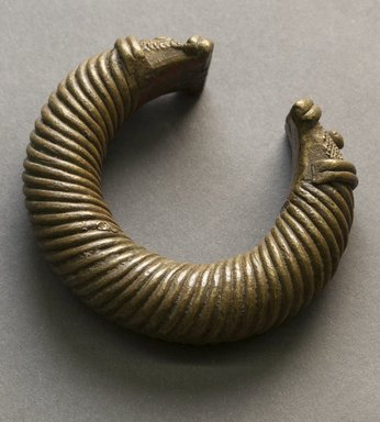 Unknown. <em>Bracelet</em>, 19th or 20th century. Copper alloy, 3 1/4 in. (8.3 cm) x 2 3/4 in. (7 cm). Brooklyn Museum, Gift of Mr. and Mrs. Arnold Syrop, 1993.183.11. Creative Commons-BY (Photo: Brooklyn Museum, 1993.183.11_front_PS10.jpg)
