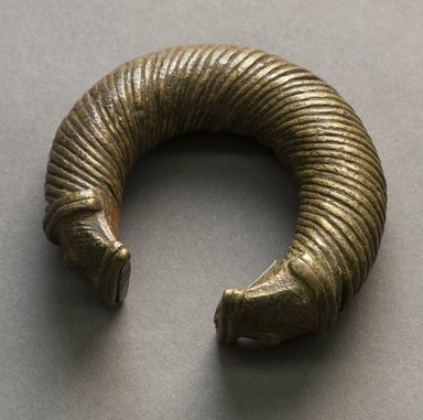 Unknown. <em>Bracelet</em>, 19th or 20th century. Copper alloy, 2 7/8 x 3 1/4 in. (7.3 x 8.3 cm). Brooklyn Museum, Gift of Mr. and Mrs. Arnold Syrop, 1993.183.12. Creative Commons-BY (Photo: Brooklyn Museum, 1993.183.12_front_PS10.jpg)
