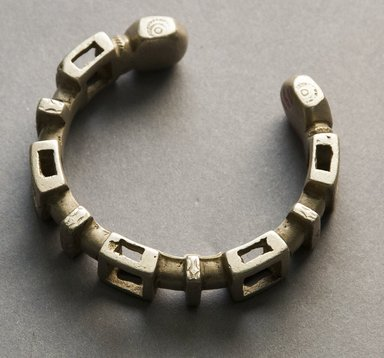 Nupe. <em>Bracelet</em>, 19th or 20th century. White metal alloy, 2 1/2 x 2 5/8 in. Brooklyn Museum, Gift of Mr. and Mrs. Arnold Syrop, 1993.183.5. Creative Commons-BY (Photo: Brooklyn Museum, 1993.183.5_front_PS10.jpg)