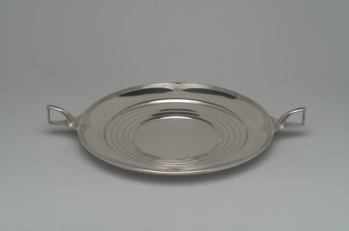 Alfred G. Kintz (American, 1885-1963). <em>Plate, Ebbtide</em>, ca. 1928. Silver, 1 3/4 x 13 3/16 x 10 1/16in. (4.4 x 33.5 x 25.6cm). Brooklyn Museum, Gift of Daniel Morris and Denis Gallion, 1993.208.2. Creative Commons-BY (Photo: Brooklyn Museum, 1993.208.2.jpg)