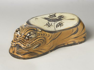<em>Cizhou Ware Pillow in the Form of a Tiger</em>, 1182. Cizhou ware, earthenware, painted slip decoration with transparent glaze, 4 3/8 x 6 3/4 x 14 1/2 in. (11.1 x 17.1 x 36.8 cm). Brooklyn Museum, Gift of the Asian Art Council, 1993.56. Creative Commons-BY (Photo: Brooklyn Museum, 1993.56_overall_PS9.jpg)