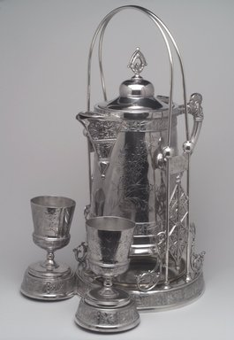 Pairpoint Manufacturing Company (1880-1929). <em>Pitcher on Stand</em>, ca. 1885. Silverplate, Pitcher: 13 x 10 15/16 x 7 3/4 in. (33 x 27.8 x 19.7 cm). Brooklyn Museum, Gift of Paul F. Walter, 1994.119.2a-c. Creative Commons-BY (Photo: , 1994.119.2a-c_1994.119.3_1994.119.4.jpg)