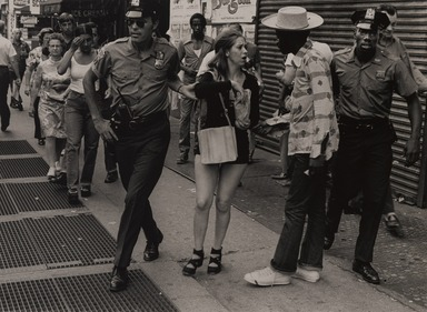 Michael Hanulak (American, 1937-2011). <em>Prostitute and Pimp</em>, 1974. Gelatin silver photograph, image: 9 1/4 x 12 1/2 in. (23.5 x 31.8 cm). Brooklyn Museum, Purchased with funds given by the Horace W. Goldsmith Foundation, Harry Kahn, and Mrs. Carl L. Selden, 1994.129.1. © artist or artist's estate (Photo: , 1994.129.1_PS9.jpg)
