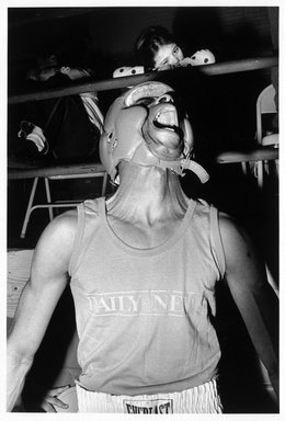Eva Lipman (Amercican, born Czechoslovakia, 1947). <em>Amateur Boxer, Golden Gloves Competition, Madison Square Garden, N.Y.C.</em>, 1990. Gelatin silver photograph, sheet: 19 3/4 × 15 7/8 in. (50.2 × 40.3 cm). Brooklyn Museum, Gift of the artist, 1994.137. © artist or artist's estate (Photo: Brooklyn Museum, 1994.137_bw.jpg)