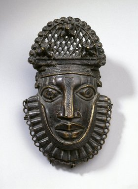 Edo. <em>Hip Ornament with Human Face (Uhunmwun-ekue)</em>, 18th century (possibly). Copper alloy, iron, 6 13/16 × 4 5/16 × 2 1/4 in. (17.3 × 11 × 5.7 cm). Brooklyn Museum, Gift of Beatrice Riese, 1994.143. Creative Commons-BY (Photo: Brooklyn Museum, 1994.143_SL1.jpg)
