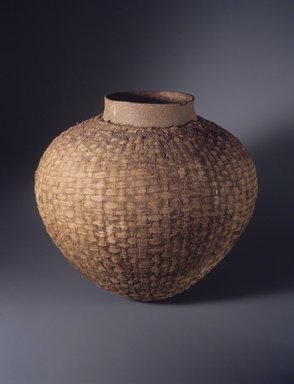 Thonga. <em>Globular Pot</em>, late 19th-early 20th century. Ceramic, fiber, organic materials, 14 1/2 × 21 in. (36.8 × 53.3 cm). Brooklyn Museum, Gift of Bill and Gale Simmons, 1994.144.1. Creative Commons-BY (Photo: Brooklyn Museum, 1994.144.1_transpc002.jpg)
