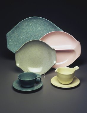 Russel Wright (American, 1904-1976). <em>Miniature Gravy Boat with Plate, Idealware Pattern</em>, 1955-1962. Molded polyethylene plastic, 1 3/4 x 2 3/4 x 7 5/8 in. (4.5 x 19.3 x 6.0 cm). Brooklyn Museum, Gift of Paul F. Walter, 83.108.107a-b. Creative Commons-BY (Photo: Brooklyn Museum, 1994.165.61_83.108.104_1999.29.48_83.108.104_83.108.91a-b_83.108.103_83.108.107.jpg)