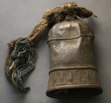 Veri. <em>Bell</em>, early 20th century. Copper alloy, bone, cloth, string, yarn, h: 8 3/4 in. (22.3 cm). Brooklyn Museum, Gift of Drs. John I. and Nicole Dintenfass, 1994.182.9. Creative Commons-BY (Photo: Brooklyn Museum, 1994.182.9_front_PS10.jpg)