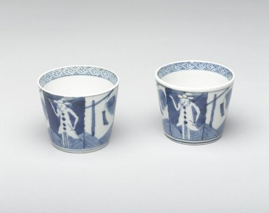 <em>Soba Cup, One of Pair</em>, early 19th century. Porcelain with cobalt blue underglaze design of Dutch merchants and signal flags., 3 1/16 x 3 1/8 in. (7.7 x 7.9 cm). Brooklyn Museum, Gift of Robert S. Anderson, 1994.188.2. Creative Commons-BY (Photo: , 1994.188.2_1994.188.3_view1_PS4.jpg)