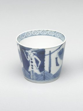 <em>Soba Cup, One of Pair</em>, early 19th century. Porcelain with cobalt blue underglaze design of Dutch merchants and signal flags., 3 1/16 x 3 1/8 in. (7.7 x 7.9 cm). Brooklyn Museum, Gift of Robert S. Anderson, 1994.188.2. Creative Commons-BY (Photo: Brooklyn Museum, 1994.188.2_PS4.jpg)