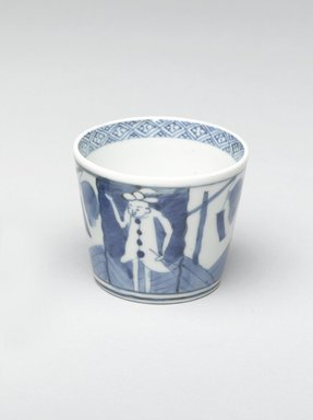 <em>Soba Cup, One of Pair</em>, early 19th century. Porcelain with cobalt blue underglaze design of Dutch merchants and signal flags., 3 1/8 x 3 1/16 in. (7.9 x 7.8 cm). Brooklyn Museum, Gift of Robert S. Anderson, 1994.188.3. Creative Commons-BY (Photo: Brooklyn Museum, 1994.188.3_PS4.jpg)