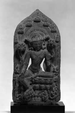 <em>Stele with Seated Avalokiteshvara</em>, ca. 11th-12th century. Dark gray stone, 19 3/4 x 9 7/8 in.  (50.2 x 25.1 cm). Brooklyn Museum, Gift of Mr. and Mrs. Paul E. Manheim, 1994.199.4. Creative Commons-BY (Photo: Brooklyn Museum, 1994.199.4_bw_IMLS.jpg)