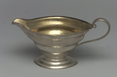 Reed & Barton (American, 1840-present). <em>Creamer, Modernist Patter, Part of a 4-Piece Set</em>, 1928-1929. Silver, 2 7/8 x 5 3/4 x 3 in. (7.3 x 14.6 x 7.6 cm). Brooklyn Museum, Gift of Daniel Morris and Denis Gallion, 1994.205.13. Creative Commons-BY (Photo: Brooklyn Museum, 1994.205.13.jpg)