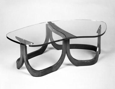 Unknown. <em>Low Table; Two Sections</em>, ca. 1955. Walnut and glass, Overall: width:53 in. (134.5 cm) diameter: 29 in. (73.6 cm)--. Brooklyn Museum, Gift of Paul F. Walter in memory of May E. Walter, 1994.21.2a-d. Creative Commons-BY (Photo: Brooklyn Museum, 1994.21.2a-b_bw.jpg)