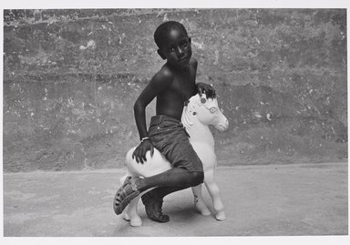 Martine Barrat (Algerian, born 1933). <em>Paris, La Goutte D'or, Mamadou</em>, 1982. Gelatin silver photograph, image: 12 1/4 x 18 in. (31.1 x 45.8 cm). Brooklyn Museum, Gift of the artist, 1994.6.1. © artist or artist's estate (Photo: Brooklyn Museum, 1994.6.1_PS9.jpg)