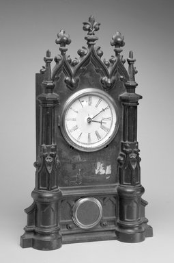 C. Chinnocks. <em>Clock and Key</em>, ca. 1845-1865. Cast iron, wood, gilt metal and glass, 20.25 x 12.5 x 4.75 in.  (51.4 x 31.8 x 12.1 cm). Brooklyn Museum, Gift of David A. Hanks in memory of Henry P. McIlhenny, 1995.105a-b. Creative Commons-BY (Photo: Brooklyn Museum, 1995.105a-b_bw.jpg)