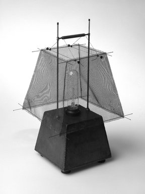 Emily McLennan (American, 1943-2003). <em>Steelite #5, Lamp</em>, Designed and Made 1994. Steel, fiberglass, wood, rubber, thread, 15 x 10 1/4 x 10 1/4 in. (38.1 x 26 x 26 cm). Brooklyn Museum, Gift of Lisl Steiner Monchek, 1995.109. Creative Commons-BY (Photo: Brooklyn Museum, 1995.109_bw.jpg)