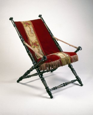 P.J. Hardy (American, 19th century). <em>Folding Chair</em>, Patented 1867. Ebonized wood, metal, original upholstery, 36 x 25 3/4 x 32 1/4 in.  (91.4 x 65.4 x 81.9 cm). Brooklyn Museum, Gift of Norman Mizuno and Alan J. Davidson, 1995.110. Creative Commons-BY (Photo: Brooklyn Museum, 1995.110_IMLS_SL2.jpg)