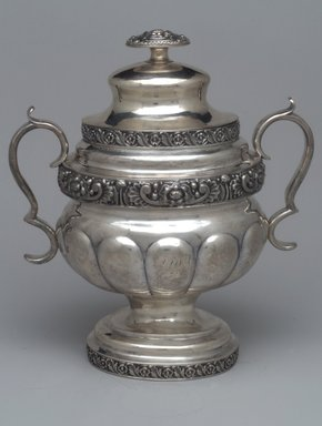 Unknown. <em>Sugar Bowl with Lid,  Part of Three-Piece Set</em>, ca. 1826-1828. Silver, 9 3/4 x 8 1/2 x 5 3/4 in. (14.7 x 21.6 x 13.3 cm). Brooklyn Museum, Gift of Marcelle H. Littell, 1995.151.3a-b. Creative Commons-BY (Photo: Brooklyn Museum, 1995.151.3a-b.jpg)