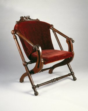 George Jacob Hunzinger (American, born Germany, 1835-1898). <em>Folding Chair</em>, ca. 1873. Wood, original upholstery, 31 5/8 x 27 1/2 x 29 1/4 in.  (80.3 x 69.9 x 74.3 cm). Brooklyn Museum, Gift of Norman K. Mizuno and Alan J. Davidson, 1995.153. Creative Commons-BY (Photo: Brooklyn Museum, 1995.153_IMLS_SL2.jpg)