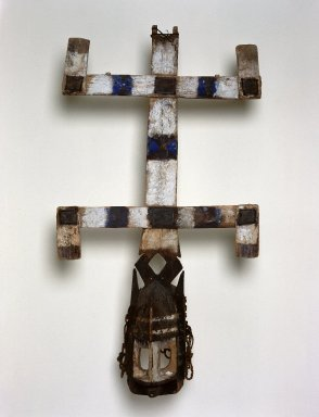 Dogon. <em>Mask (Kanaga)</em>, 20th century. Wood, leather, pigment, vegetable fiber, 42 1/2 x 23 1/4 x 9 in. (108 x 59.1 x 22.9 cm). Brooklyn Museum, Gift of Allen C. Davis, 1995.171.11a-c. Creative Commons-BY (Photo: Brooklyn Museum, 1995.171.11a-c_SL1.jpg)