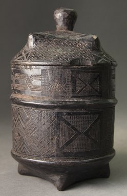 Kuba (Shoowa subgroup). <em>Storage Box for Tukula Powder (Kukia)</em>, 20th century. Wood, camwood (inside and in carving), height (including lid): 7 in. (17.8 cm). Brooklyn Museum, Gift of Allen C. Davis, 1995.171.1a-b. Creative Commons-BY (Photo: Brooklyn Museum, 1995.171.1a-b_side_PS10.jpg)