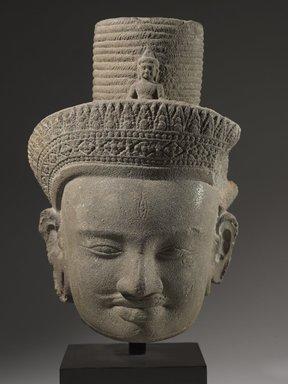 <em>Head of Bodhisattva Avalokiteshvara</em>, 10th century. Gray sandstone, 11 1/2 x 7 1/2 x 7 1/2in. (29.2 x 19.1 x 19.1cm). Brooklyn Museum, Gift of Georgia and Michael de Havenon, 1995.180.1. Creative Commons-BY (Photo: Brooklyn Museum, 1995.180.1_front_PS6.jpg)
