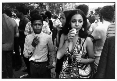 Garry Winogrand (American, 1928-1984). <em>Untitled (Woman and Young Man Eating Ices), from Women are Beautiful Series</em>. Gelatin silver photograph, sheet: 11 x 14 in. (27.9 x 35.5 cm). Brooklyn Museum, Gift of Mitchell F. Deutsch, 1995.206.11. © artist or artist's estate (Photo: Brooklyn Museum, 1995.206.11_bw.jpg)
