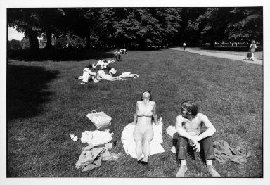 Garry Winogrand (American, 1928-1984). <em>Untitled (Woman and Man Sunning Themselves in a Park), from Women are Beautiful Series</em>. Gelatin silver photograph, sheet: 11 x 14 in. (27.9 x 35.5 cm). Brooklyn Museum, Gift of Mitchell F. Deutsch, 1995.206.15. © artist or artist's estate (Photo: Brooklyn Museum, 1995.206.15_bw.jpg)
