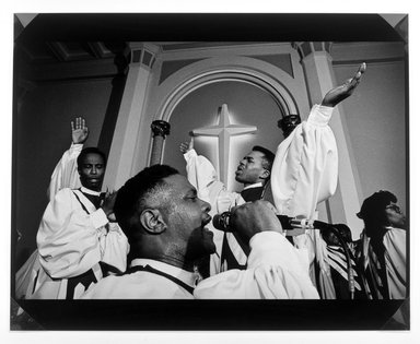 Arlene Gottfried (American, 1950-2017). <em>Selwyn Rawls and the Eternal Light Community Singers</em>, 1990. Silver dye bleach photograph (Cibachrome), image: 13 x 19 1/2 in. (33 x 49.5 cm). Brooklyn Museum, Purchased with funds given by the Horace W. Goldsmith Foundation, Harry Kahn, Mrs. Carl L. Selden, and an anonymous donor, 1995.40. © artist or artist's estate (Photo: Brooklyn Museum, 1995.40_bw.jpg)