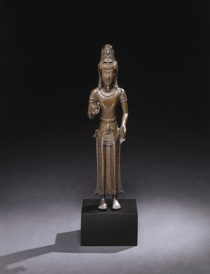 <em>Bodhisattva Guanyin</em>, 11th-12th century. Cast bronze, traces of gilding, 19 1/8 x 5 x 2 3/4 in. (48.6 x 12.7 x 7 cm). Brooklyn Museum, Gift of the Asian Art Council, 1995.48. Creative Commons-BY (Photo: Brooklyn Museum, 1995.48_SL1.jpg)