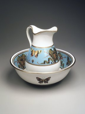 Minton and Company (1849-1878). <em>Pitcher and Basin</em>, ca. 1870. Glazed porcelain, Pitcher: height 11 1/4 in (28.6 cm) width 8 1/4in. (21 cm) diameter 7 1/2 in. (19 cm) Basin: height 4 5/8 in. (11.9 cm) diameter 14 3/4in. (37.5 cm). Brooklyn Museum, Bequest of Marie Bernice Bitzer, by exchange, 1995.58.1a-b. Creative Commons-BY (Photo: Brooklyn Museum, 1995.58.1a-b_transp629.jpg)