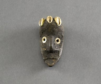Dan. <em>Personal Miniature Mask</em>, 20th century. Wood, shell, 3 1/8 x 1 1/2in. (7.9 x 3.8cm). Brooklyn Museum, Gift of Blake Robinson, 1995.7.10. Creative Commons-BY (Photo: Brooklyn Museum, 1995.7.10_front_PS5.jpg)