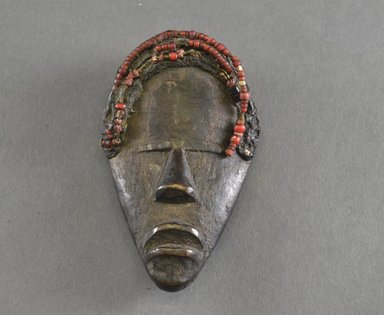 Dan. <em>Personal Miniature Mask</em>, 20th century. Wood, beads, organic matter?, 4 3/4 x 2 5/8in. (12.1 x 6.7cm). Brooklyn Museum, Gift of Blake Robinson, 1995.7.15. Creative Commons-BY (Photo: Brooklyn Museum, 1995.7.15_front_PS5.jpg)