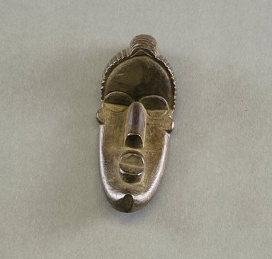 Bassa. <em>Personal Miniature Mask</em>, 20th century. Wood, 5 x 1 7/8in. (12.7 x 4.8cm). Brooklyn Museum, Gift of Blake Robinson, 1995.7.19. Creative Commons-BY (Photo: Brooklyn Museum, 1995.7.19_front_PS5.jpg)