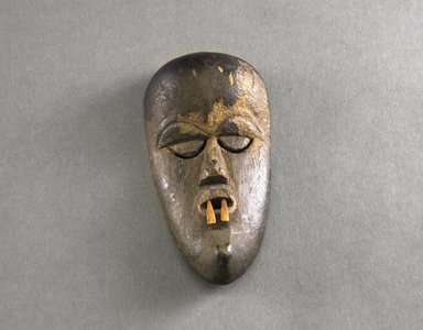 Dan. <em>Personal Miniature Mask</em>, 20th century. Wood, fur, metal, 10 1/2 x 2 in. (26.7 x 5.1 cm). Brooklyn Museum, Gift of Blake Robinson, 1995.7.1. Creative Commons-BY (Photo: Brooklyn Museum, 1995.7.1_front_PS5.jpg)