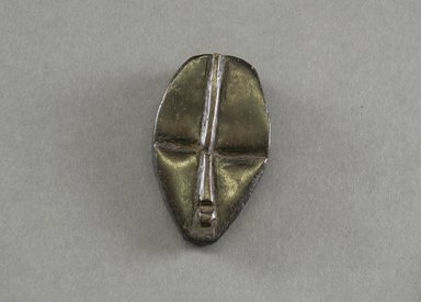 Dan. <em>Personal Miniature Mask</em>, 20th century. Wood, 3 1/2 x 2 1/8in. (8.9 x 5.4cm). Brooklyn Museum, Gift of Blake Robinson, 1995.7.20. Creative Commons-BY (Photo: Brooklyn Museum, 1995.7.20_front_PS5.jpg)