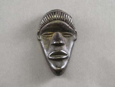 Dan. <em>Personal Miniature Mask</em>, 20th century. Wood, 3 3/4 x 2 3/8 x 1in. (9.5 x 6 x 2.5cm). Brooklyn Museum, Gift of Blake Robinson, 1995.7.23. Creative Commons-BY (Photo: Brooklyn Museum, 1995.7.23_front_PS5.jpg)
